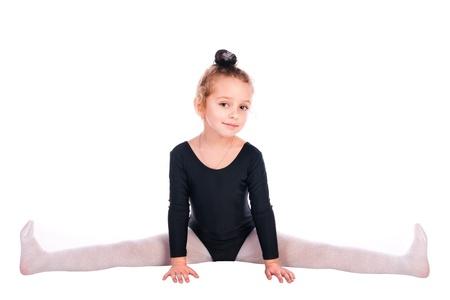 白い背景で隔離の女の子の体操選手