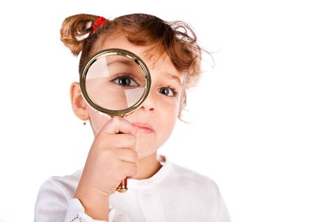 girl with magnifier isolated on a white background Stock Photo - 11313494