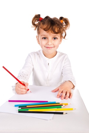 girl draw picture by color pencils isolated on a white background photo