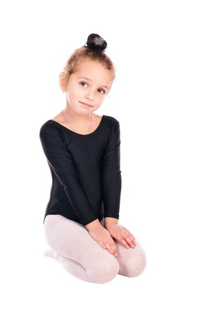 girl gymnast isolated on a white background photo