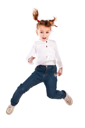 jumping girl isolated on a white background photo