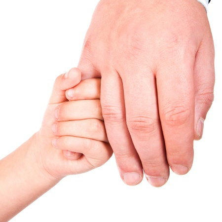 infant hand: child holds father hand isolated on a white background