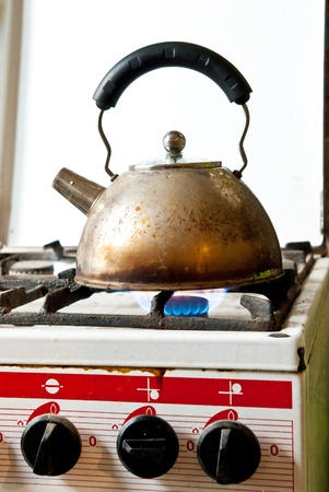 old kettle on a old stove photo