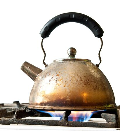 old kettle on a stove isolated on a white background photo