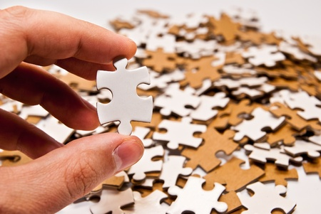 hand holding single puzzle piece Stock Photo - 12782050