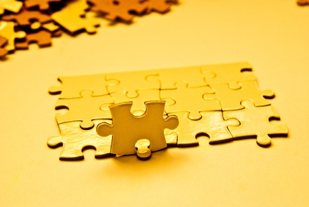 heap of golden puzzle pieces photo