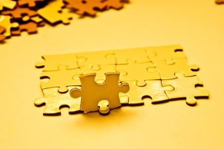 heap of golden puzzle pieces Stock Photo - 12782033
