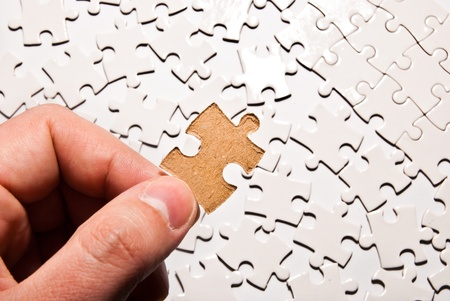 hand holding single puzzle piece Stock Photo - 12782040