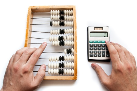 reckon: old abacus with calculator and hands