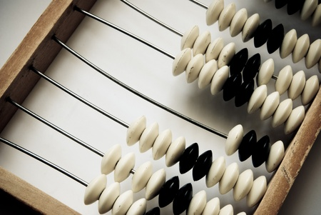old abacus closeup on a grey background photo