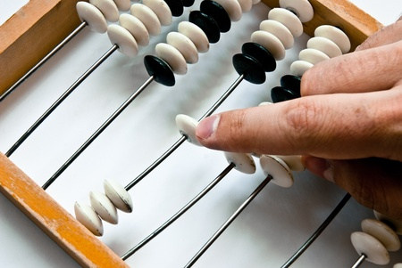 reckon: old abacus with human hand