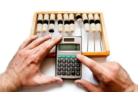 old abacus with calculator and hands photo