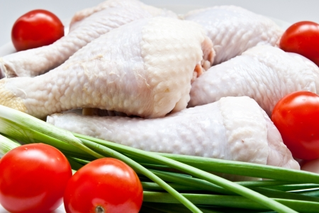 raw chicken with vegetables as a background photo