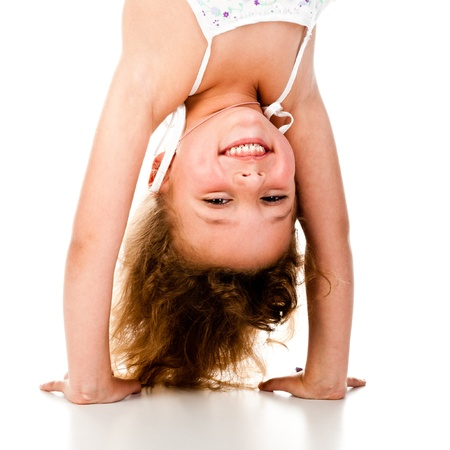 little girl upside down on a white background photo