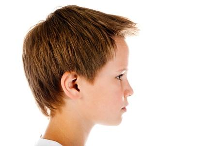 kinderen: jongen gezicht geïsoleerd op een witte achtergrond Stockfoto