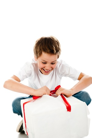 opening gift: boy with gift isolated on a white background Stock Photo