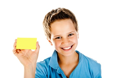 boy with yellow card isolated on a white background Standard-Bild