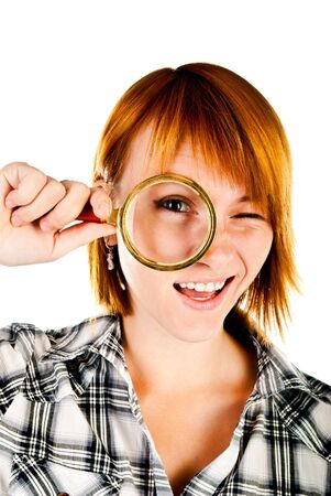 woman with magnifying glass isolated on a white background photo