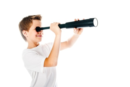 little boy with telescope isolated on a white background photo