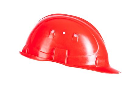 casco rojo: casco rojo aislado en un fondo blanco Foto de archivo