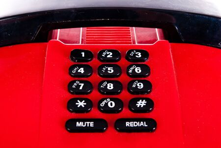 old red electronic telephone closeup photo