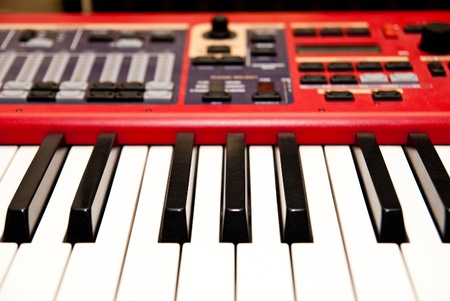 electronic synthesizer with keyboard and knobs closeup photo