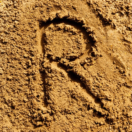 alphabet letter R made from sand photo