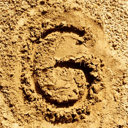 alphabet letter G made from sand photo