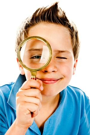 eye glass: little boy with magnifier on a white background Stock Photo