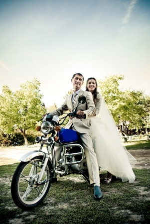glamour couple: bride and groom on the motorcycle