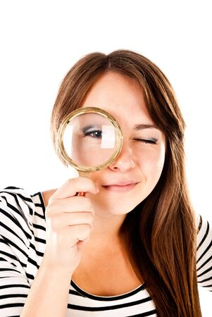 young woman with magnifying glass isolated on a white background photo