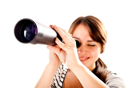 young woman with telescope isolated on a white background photo