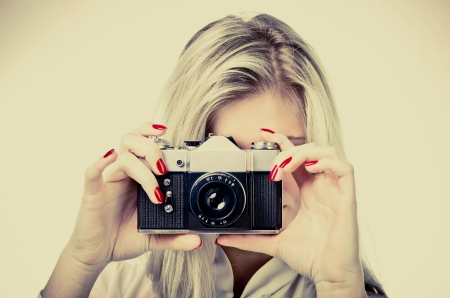 woman with old camera vintage style Standard-Bild
