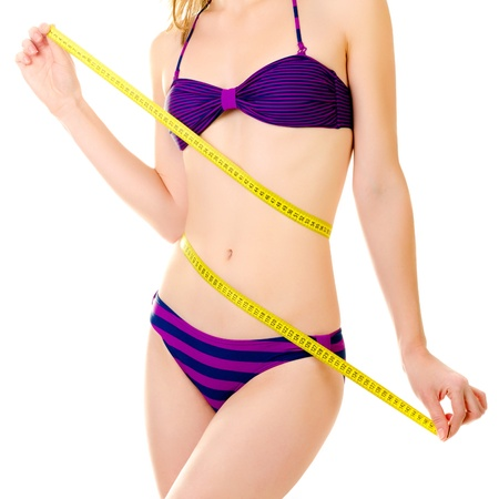 woman measuring her waist isolated on a white background photo