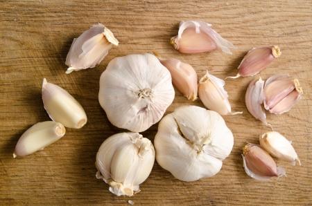 garlic: raw garlic on a wooden plank