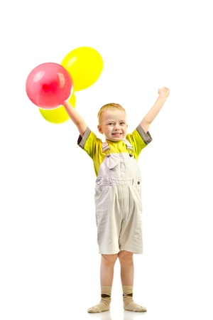little boy with balloons isolated on a white background photo