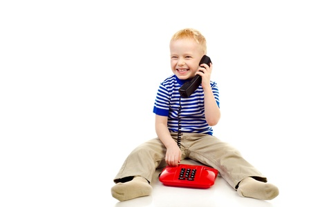 little boy with telephone isolated on a white background photo