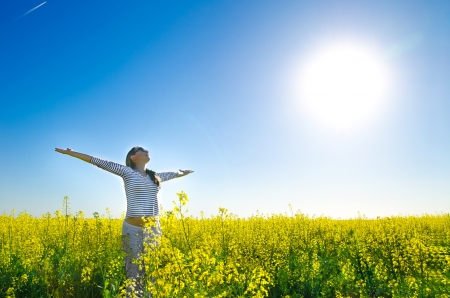 woman standing in the field Stock Photo