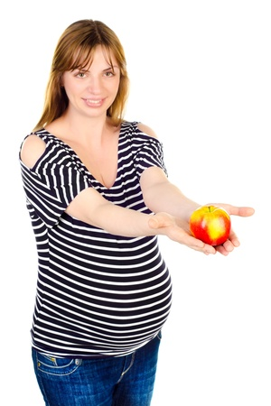 pregnant woman with apple isolated on a white background photo