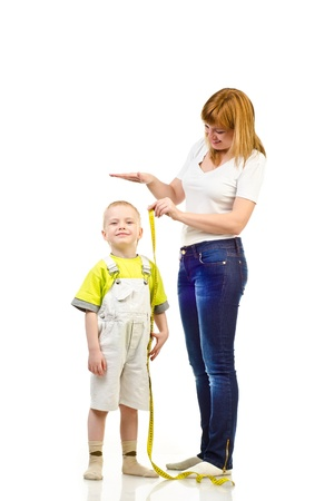 measure height: woman measuring child isolated on a white background
