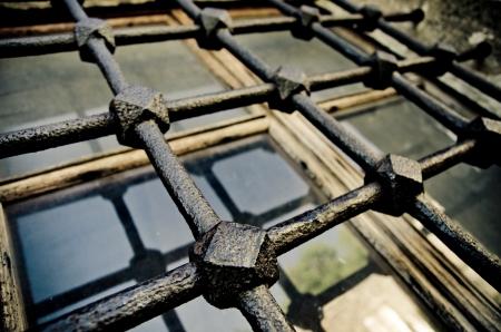 old iron window bars closeup Фото со стока