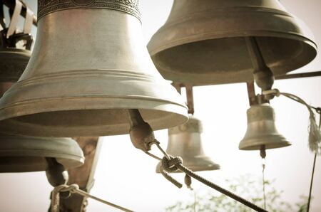 church bell: a lot of bells in a church Stock Photo