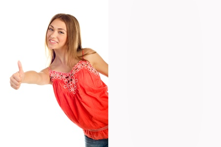 young girl giving a thumb up behind a white board Stock Photo - 21334351