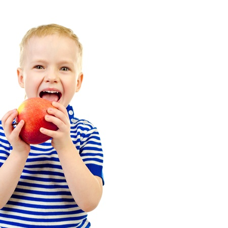 little boy with apple isolated on a white background photo
