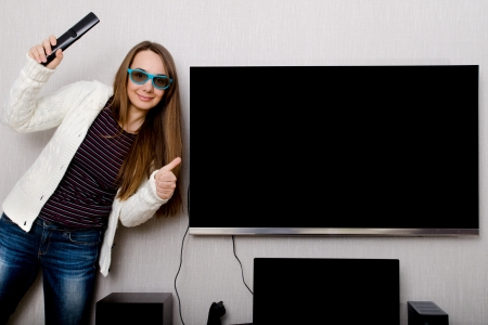 woman in 3d glasses with tv indoors photo