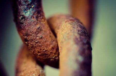 corrode: old rusty chain link macro
