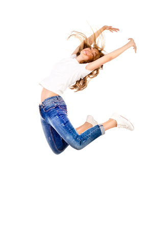 young jumping girl isolated on a white background photo