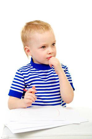 little boy draw picture isolated on a white background photo