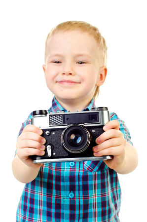 little boy with camera isolated on a white background photo