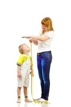 woman measuring child isolated on a white background